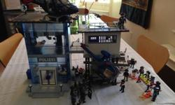Complete Police Playmobil set including 2 Helicopters, Police Station incl. alarmed prison, Police Transporter, Special Unit Racer, Police People, Special Forces, Thieves, road stop equipment, bicycles and animals. Great fun and our kid enjoyed playing