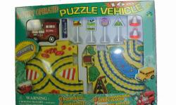 Puzzle Vehicle 16 Piece AAA Battery Powered Sets - $17 each set All New in very compact boxes. AAA Battery included and installed. 1 Vehicle, 1 AAA Battary, 8 pieces of Puzzle Track, and four signs. Four different sets available: Locomotive School Bus