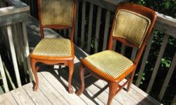 2 Antique solid oak and upholstered (seats/backrests)Queen Anne Style chairs. Seats are removable. Upholstery in 'like new' condition. Overall, chairs are tight and are in excellent condition! ---Reasonable offers considered...Make me an offer!