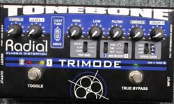 Used, one owner, immaculate condition. Perfect. Original manual and power supply included. The 12AX7 tube-equipped Radial Tonebone TriMode Distortion Pedal has true-bypass and 2 distorted channels with separate input drive and output level controls. It