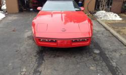 Red corvette convertable, mint condition, automatic, A.C., C.D. player, and garage kept.
