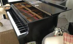 This piano is in excellent playing condition!
