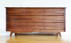 Walnut 9 Drawer credenza or dresser by Vic-Art. Great quality and lots of character. This piece screams Mid-Century Modern, for a reasonable price. Cash or PayPal accepted. Local delivery available.