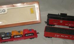 USA SHIPS FREE! For sale is a lot of three (3) HO Scale GREAT NORTHERN ROLLING STOCK. You will receive: * 1 - TYCO - 40' Skid Flat Car with 3 Tractors (has all detail parts) in the original box (plastic window partly off); Tyco item #351-B - tractors are