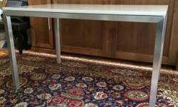 "Custom made Portica table by Room and Board. Stainless steel frame, 1 1/2"" square stainless steel, with 3/4"" thick Beige quartz composite top. Width: 48"" Depth: 30"" Height: 29"" $575 (originally $1399.00)"