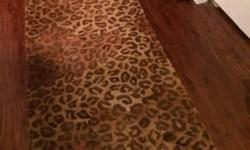 All over leopard print hand-made, 100% wool pile rug runner. Perfect for long hallway. Size: 11 ft. 10 inches x 2 ft. 3 inches $75(originally $350)