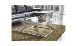 This is a brand new unused glass top coffee table purchased from Wayfair. Sides have a small scrape and a dent (not very noticeable). Original price is $235. Signature Design by Ashley Cayden Coffee Table FEATURES: The sleek contemporary design of this