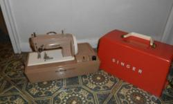 This is a vintage collectible; from 50's. In working order. Box available. A working electric sewing machine for a child. Comes with carrying case