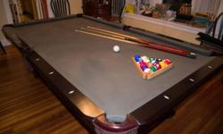 Like new standard grade pool table made of solid cherry with Queen Anne style legs. Comes with complete set of billiard balls, 3 cues, triangle, chalk, bridge and brush. 8' long and 30'' high. Perfect gift for yourself or a loved one. Top notch quality