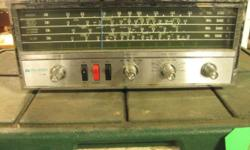 "Solid State 4-Band Table Radio Midland International Model 11-500 AM / Shortwave AM / SW1 / SW2 / SW3 9 Transistors, 3 Diodes Shortwave Electrical Fine Tuning Lighted Slide Dial 4"" Speaker Note: one of the buttons is stuck on ""receive"" (radio can't"