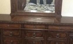 4 piece solid wood bedroom set. King size bed with four posts. Two side dressers and one full dresser with mirror. Kept in smoke-free and pet-free home. Dimensions upon request. Original Price $6500