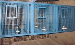 Blue triple bird cage, on wheels. Bowls, trays, and keys. Cage is in very good condition and clean.
