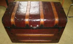 Steamer trunk metal clad with oak ribs in restored condition. Asking $75.00