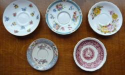 "SAUCERS Top Row descriptions(first photo) 1-Says Crown Staffordshire, England, fine bone china. Has green marks on back, pansies and violets, 5 ½"" diameter dated 1930s onward 2-Says Tuscan fine English bone china says ""Made in England"" mark is in olive"