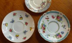 Descriptions: Top photo?Lenox ?Ming? Pattern, black mark on back, 4 ½? diameter. Lower left?Crown Staffordshire, England, fine bone china, green marks on back, 5 ½? diameter Lower right?Tuscan fine English bone china says ?Made in England? mark is in