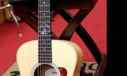This Taylor GS Mini Limited Edition Holden Village Acoustic has had one owner, less than an hour of playing time and is in ABSOLUTELY PERFECT MINT condition. No marks, no cracks, no dings, no defects. This is a hair's breadth from new. Here's some more