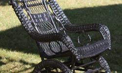 Late nineteenth century Victorian wicker platform rocking chair--painted black. Very good condition. No cushion.