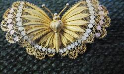 "Vintage gold vermeil and silver (marked 800) filigree butterfly pin. The pin is 2"" by 1 1/4"" and is marked 800 on the back."