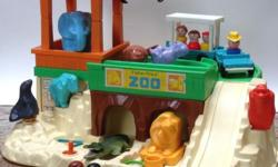 Selling a vintage Fisher Price Zoo, circa 1984, complete with train, people and picnic set. Number $916, beautiful pre-owned condition. It's about 12 inches high, 18 inches wide and 15 inches deep. Includes all the little food trays, toucans, parrots,