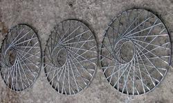 "3 deluxe spoke wire wheel covers. These may be from a Cadillac, one was crushed and I dont know if they are supposed to have some kind emblem or badge for the centers. Believe they are spring friction fit for 15"" rims, there is a notch in the outer rings"