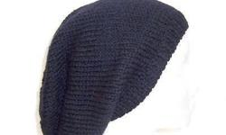 A wool handmade oversized beanie hat that is100% wool. This oversized beanie is solid black. Suitable for men and women and teens. It is made with a soft pure wool yarn. Completely hand knitted. Large size. Medium thickness, very stretchy, will fit any