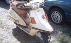 This is a great running Yamaha Scooter. It has a 4 stroke 180cc air cooled gasoline engine. I just put in a new battery. It's 72 inches long and weighs 269 pounds. All the lights works except for the dash lights. I'm selling it cheap because it has no